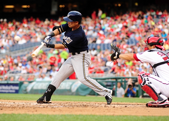 Jul 1, 2013; Washington, DC, USA; Milwaukee Brewers outfielder Norichika Aoki (7) singles in the third inning against the Washington Nationals at Nationals Park. Mandatory Credit: Evan Habeeb-USA TODAY Sports