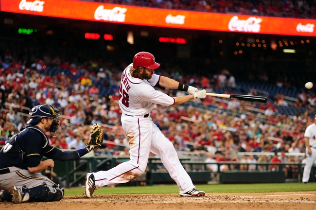 Jul 1, 2013; Washington, DC, USA; Washington Nationals outfielder Jayson Werth (28) hits a two run double during the third inning against the Milwaukee Brewers at Nationals Park. Mandatory Credit: Evan Habeeb-USA TODAY Sports