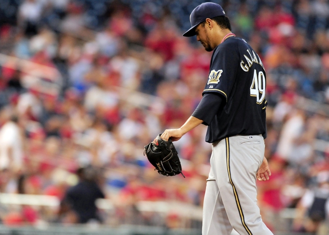 Jul 1, 2013; Washington, DC, USA; Milwaukee Brewers pitcher Yovani Gallardo (49) walks off the field after being taken out of the game in the fourth inning against the Washington Nationals at Nationals Park. Mandatory Credit: Evan Habeeb-USA TODAY Sports