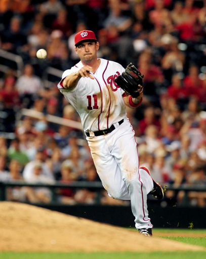 Jul 1, 2013; Washington, DC, USA; Washington Nationals third baseman Ryan Zimmerman (11) throws the ball to first during the game against the Milwaukee Brewers at Nationals Park. Mandatory Credit: Evan Habeeb-USA TODAY Sports