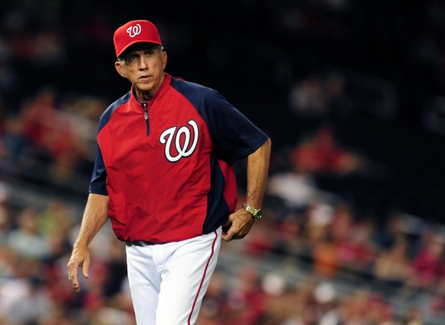 Jul 1, 2013; Washington, DC, USA; Washington Nationals manager Davey Johnson walks off the field after a pitching change during the game against the Milwaukee Brewers at Nationals Park. Mandatory Credit: Evan Habeeb-USA TODAY Sports
