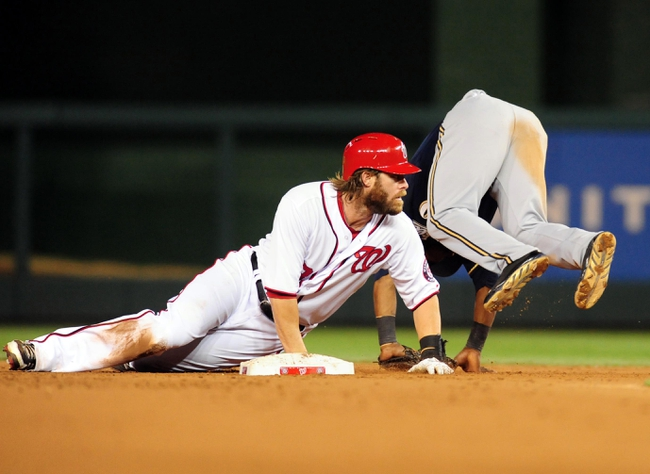 Jul 1, 2013; Washington, DC, USA; Milwaukee Brewers shortstop Jean Segura (9) jumps over Washington Nationals outfielder Jayson Werth (28) while attempting to turn a double play at Nationals Park. Mandatory Credit: Evan Habeeb-USA TODAY Sports