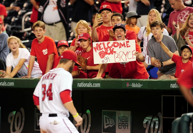 Jul 1, 2013; Washington, DC, USA; Fans of the Washington Nationals hold up a sign for outfielder Bryce Harper (34) after beating the Milwaukee Brewers 10-5 at Nationals Park. Mandatory Credit: Evan Habeeb-USA TODAY Sports