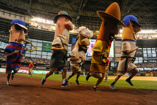 Jun 27, 2013; Milwaukee, WI, USA;  The racing sausages entertains fans during the game between the Milwaukee Brewers and Chicago Cubs at Miller Park. Mandatory Credit: Benny Sieu-USA TODAY Sports