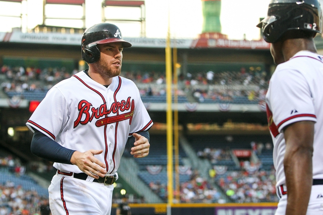Jul 2, 2013; Atlanta, GA, USA; Atlanta Braves first baseman Freddie Freeman (5) celebrates scoring with center fielder B.J. Upton (2) in the second inning against the Miami Marlins at Turner Field. Mandatory Credit: Daniel Shirey-USA TODAY Sports