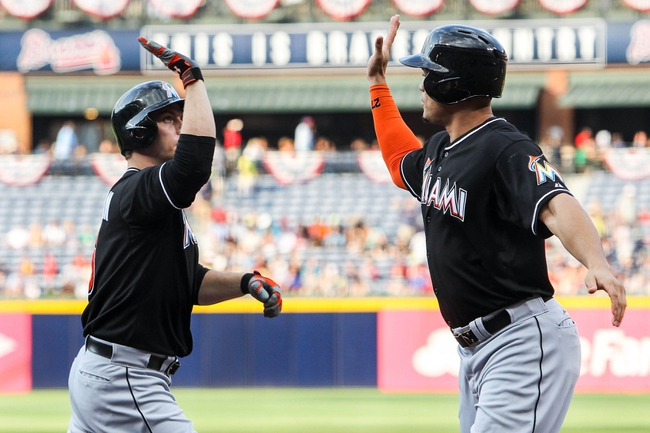 Jul 2, 2013; Atlanta, GA, USA; Miami Marlins first baseman Logan Morrison (5) celebrates a home run with right fielder Giancarlo Stanton (27) in the first inning against the Atlanta Braves at Turner Field. Mandatory Credit: Daniel Shirey-USA TODAY Sports