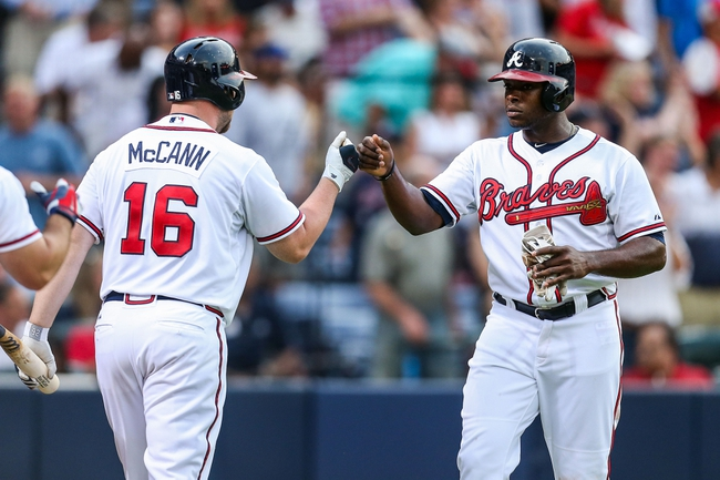 Jul 2, 2013; Atlanta, GA, USA; Atlanta Braves left fielder Justin Upton (8) celebrates with catcher Brian McCann (16) after scoring in the fourth inning against the Miami Marlins at Turner Field. Mandatory Credit: Daniel Shirey-USA TODAY Sports