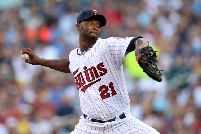 Jul 2, 2013; Minneapolis, MN, USA; Minnesota Twins starting pitcher Samuel Deduno (21) delivers a pitch in the first inning against the New York Yankees at Target Field. Mandatory Credit: Jesse Johnson-USA TODAY Sports