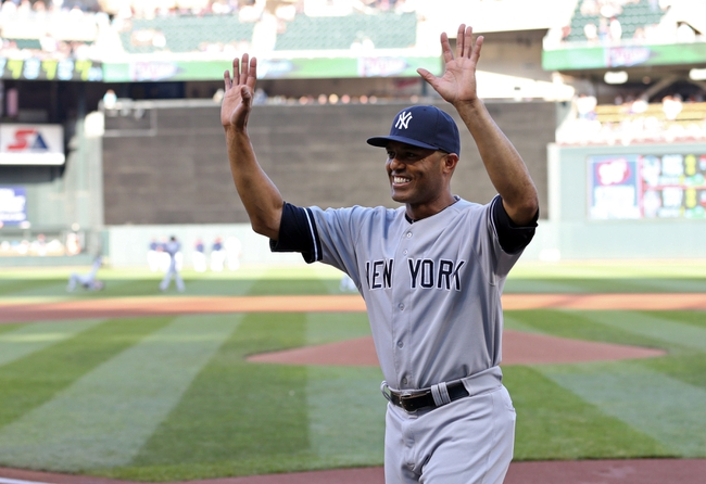 Jul 2, 2013; Minneapolis, MN, USA; New York Yankees relief pitcher Mariano Rivera (42) waves to Minnesota Twins fans after getting his gift before the game at Target Field. Mandatory Credit: Jesse Johnson-USA TODAY Sports