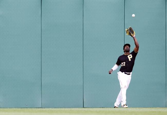 Jul 2, 2013; Pittsburgh, PA, USA; Pittsburgh Pirates center fielder Andrew McCutchen (22) makes a catch against the Philadelphia Phillies during the fourth inning at PNC Park. Mandatory Credit: Charles LeClaire-USA TODAY Sports