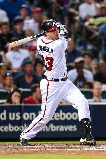 Jul 2, 2013; Atlanta, GA, USA; Atlanta Braves third baseman Chris Johnson (23) hits an RBI double in the sixth inning against the Miami Marlins at Turner Field. Mandatory Credit: Daniel Shirey-USA TODAY Sports