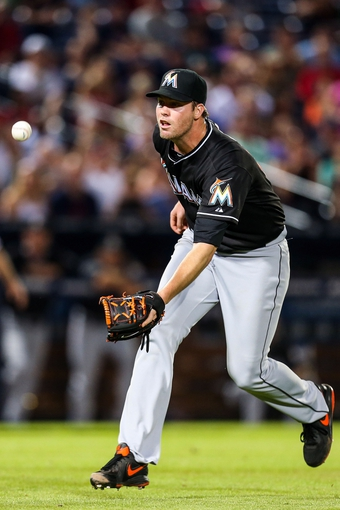 Jul 2, 2013; Atlanta, GA, USA; Miami Marlins relief pitcher Ryan Webb (58) bobbles a catch in the sixth inning against the Atlanta Braves at Turner Field. Mandatory Credit: Daniel Shirey-USA TODAY Sports