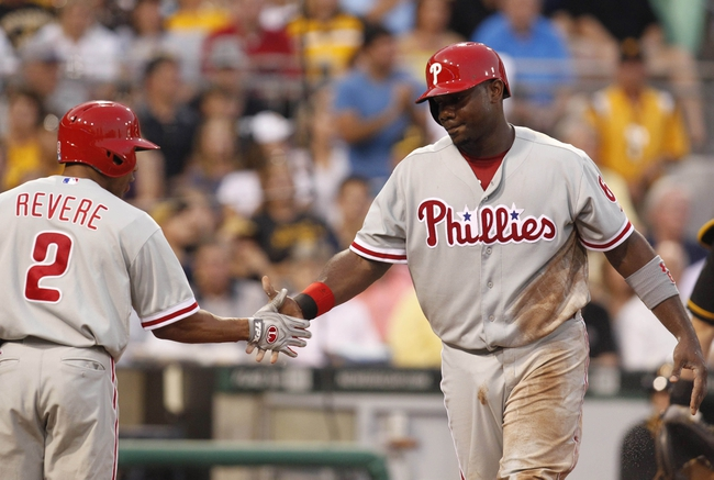 Jul 2, 2013; Pittsburgh, PA, USA; Philadelphia Phillies center fielder Ben Revere (2) greets first baseman Ryan Howard (6) after Howard scored a run against the Pittsburgh Pirates during the sixth inning at PNC Park. Mandatory Credit: Charles LeClaire-USA TODAY Sports