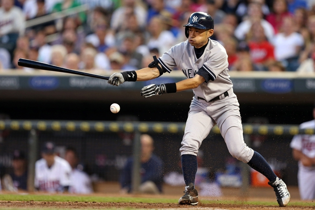 Jul 2, 2013; Minneapolis, MN, USA; New York Yankees right fielder Ichiro Suzuki (31) hits a RBI Single in the fifth inning against the Minnesota Twins at Target Field. Mandatory Credit: Jesse Johnson-USA TODAY Sports