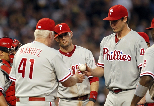 Jul 2, 2013; Pittsburgh, PA, USA; Philadelphia Phillies manager Charlie Manuel (41) makes a takes the ball from starting pitcher Jonathan Pettibone (44) on a pitching change against the Pittsburgh Pirates during the sixth inning at PNC Park. The Philadelphia Phillies won 3-1. Mandatory Credit: Charles LeClaire-USA TODAY Sports