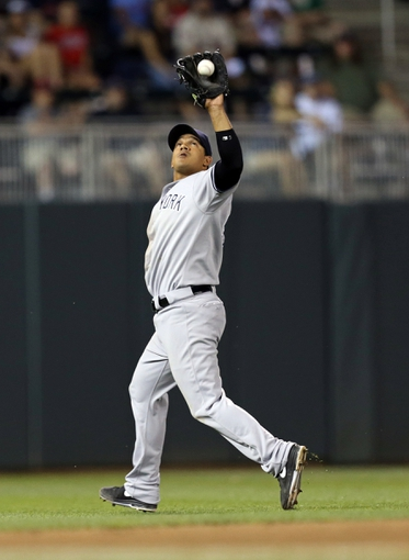 Jul 2, 2013; Minneapolis, MN, USA; New York Yankees shortstop Alberto Gonzalez (40) catches a fly ball in the seventh inning against the Minnesota Twins at Target Field. The Yankees won 7-3. Mandatory Credit: Jesse Johnson-USA TODAY Sports