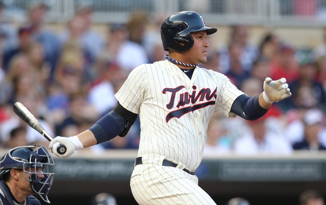 Jul 3, 2013; Minneapolis, MN, USA; Minnesota Twins outfielder Oswaldo Arcia (31) hits a single during the second inning against the New York Yankees at Target Field. Mandatory Credit: Brace Hemmelgarn-USA TODAY Sports