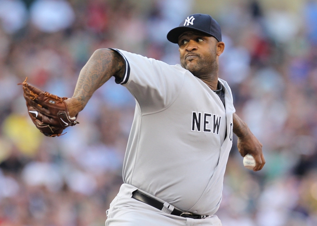 Jul 3, 2013; Minneapolis, MN, USA; New York Yankees pitcher C.C. Sabathia (52) delivers a pitch during the first inning against the Minnesota Twins at Target Field. Mandatory Credit: Brace Hemmelgarn-USA TODAY Sports