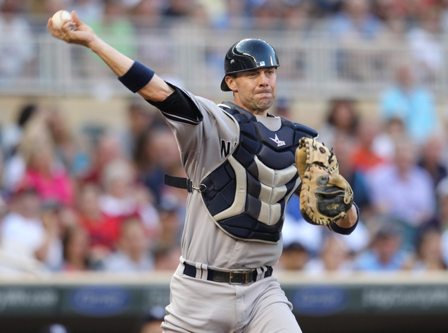 Jul 3, 2013; Minneapolis, MN, USA; New York Yankees catcher Chris Stewart (19) throws to first base during the second inning against the Minnesota Twins at Target Field. Mandatory Credit: Brace Hemmelgarn-USA TODAY Sports