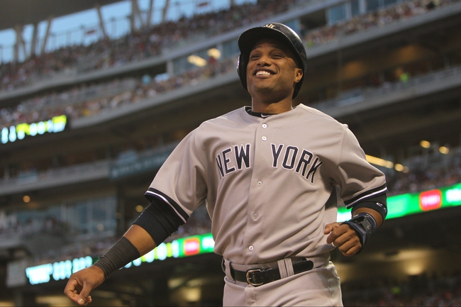 Jul 3, 2013; Minneapolis, MN, USA; New York Yankees second baseman Robinson Cano (24) smiles after scoring a run during the sixth inning against the Minnesota Twins at Target Field. Mandatory Credit: Brace Hemmelgarn-USA TODAY Sports