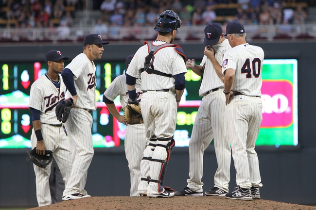 Jul 3, 2013; Minneapolis, MN, USA; Minnesota Twins pitcher P.J. Walters (39) wipes his face during a mound visit with pitching coach Rick Anderson (40) during the sixth inning against the New York Yankees at Target Field. Mandatory Credit: Brace Hemmelgarn-USA TODAY Sports