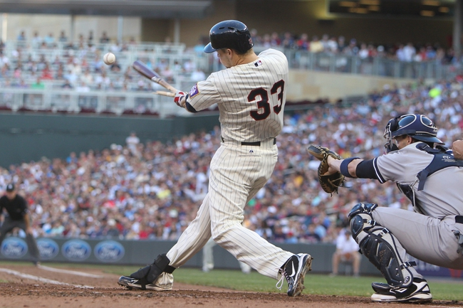 Jul 3, 2013; Minneapolis, MN, USA; Minnesota Twins first baseman Justin Morneau (33) breaks his bat during the third inning against the New York Yankees at Target Field. Mandatory Credit: Brace Hemmelgarn-USA TODAY Sports