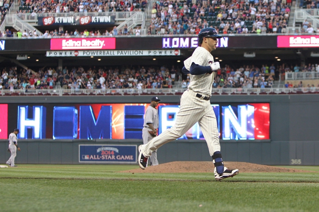 Jul 3, 2013; Minneapolis, MN, USA; Minnesota Twins third baseman Trevor Plouffe (24) rounds the bases after hitting a home run off of New York Yankees pitcher C.C. Sabathia (52) during the fifth inning Target Field. Mandatory Credit: Brace Hemmelgarn-USA TODAY Sports