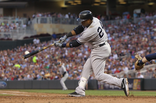 Jul 3, 2013; Minneapolis, MN, USA; New York Yankees second baseman Robinson Cano (24) hits a two-run double during the sixth inning against the Minnesota Twins at Target Field. Mandatory Credit: Brace Hemmelgarn-USA TODAY Sports