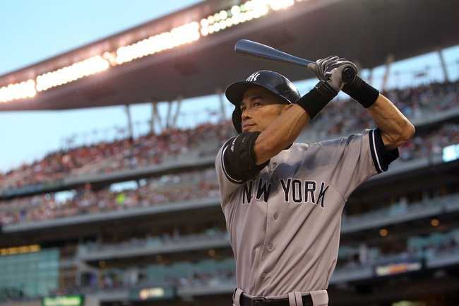 Jul 3, 2013; Minneapolis, MN, USA; New York Yankees outfielder Ichiro Suzuki (51) waits on-deck during the sixth inning against the Minnesota Twins at Target Field. Mandatory Credit: Brace Hemmelgarn-USA TODAY Sports