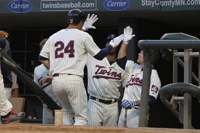 Jul 3, 2013; Minneapolis, MN, USA; Minnesota Twins third baseman Trevor Plouffe (24) is congratulated by teammates after hitting a home run during the fifth inning against the New York Yankees at Target Field. Mandatory Credit: Brace Hemmelgarn-USA TODAY Sports