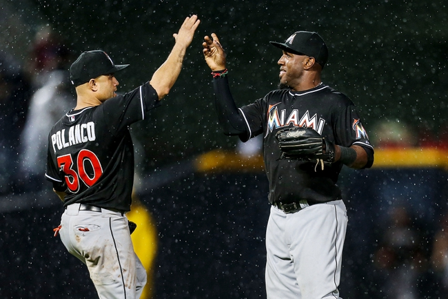 Jul 3, 2013; Atlanta, GA, USA; Miami Marlins right fielder Marcell Ozuna (48) celebrates with third baseman Placido Polanco (30) after beating the Atlanta Braves at Turner Field. The Marlins won 6-3. Mandatory Credit: Daniel Shirey-USA TODAY Sports