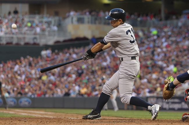 Jul 3, 2013; Minneapolis, MN, USA; New York Yankees outfielder Ichiro Suzuki (51) hits a double during the sixth inning against the Minnesota Twins at Target Field. Mandatory Credit: Brace Hemmelgarn-USA TODAY Sports