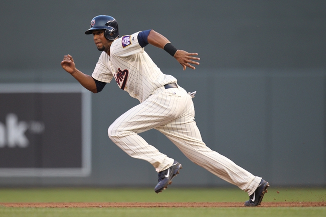 Jul 3, 2013; Minneapolis, MN, USA; Minnesota Twins outfielder Aaron Hicks (32) steals second base during the fourth inning against the New York Yankees at Target Field. Mandatory Credit: Brace Hemmelgarn-USA TODAY Sports