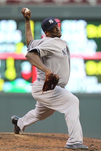 Jul 3, 2013; Minneapolis, MN, USA; New York Yankees pitcher CC Sabathia (52) delivers a pitch during the third inning against the Minnesota Twins at Target Field. Mandatory Credit: Brace Hemmelgarn-USA TODAY Sports