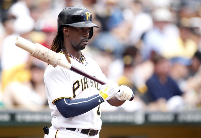 Jul 4, 2013; Pittsburgh, PA, USA; Pittsburgh Pirates center fielder Andrew McCutchen (22) waits his turn to bat in the on-deck circle against the Philadelphia Phillies during the first inning at PNC Park. Mandatory Credit: Charles LeClaire-USA TODAY Sports