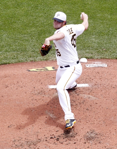 Jul 4, 2013; Pittsburgh, PA, USA; Pittsburgh Pirates starting pitcher Gerrit Cole (45) delivers a pitch against the Philadelphia Phillies during the second inning at PNC Park. Mandatory Credit: Charles LeClaire-USA TODAY Sports