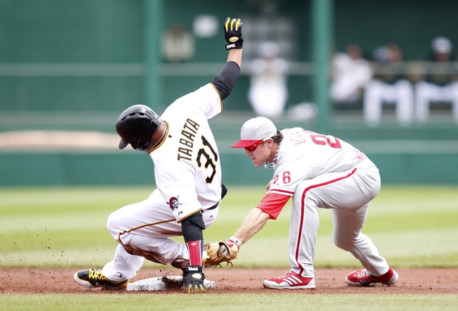 Jul 4, 2013; Pittsburgh, PA, USA; Pittsburgh Pirates right fielder Jose Tabata (31) slides safely into second base with a double as Philadelphia Phillies second baseman Chase Utley (26) reaches for a tag during the first inning at PNC Park. Mandatory Credit: Charles LeClaire-USA TODAY Sports