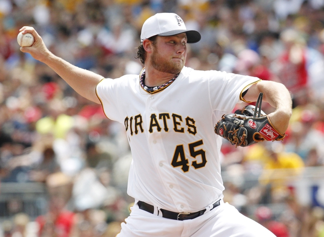 Jul 4, 2013; Pittsburgh, PA, USA; Pittsburgh Pirates starting pitcher Gerrit Cole (45) delivers a pitch against the Philadelphia Phillies during the fourth inning at PNC Park. The Philadelphia Phillies won 6-4. Mandatory Credit: Charles LeClaire-USA TODAY Sports