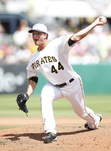 Jul 4, 2013; Pittsburgh, PA, USA; Pittsburgh Pirates relief pitcher Tony Watson (44) pitches against the Philadelphia Phillies during the sixth inning at PNC Park. The Philadelphia Phillies won 6-4. Mandatory Credit: Charles LeClaire-USA TODAY Sports