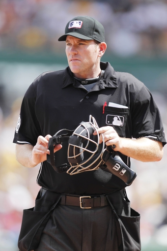 Jul 4, 2013; Pittsburgh, PA, USA; Home plate umpire Chris Conroy looks on between innings of the contest between the Philadelphia Phillies and the Pittsburgh Pirates at PNC Park. The Philadelphia Phillies won 6-4. Mandatory Credit: Charles LeClaire-USA TODAY Sports