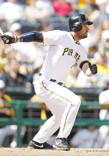 Jul 4, 2013; Pittsburgh, PA, USA; Pittsburgh Pirates pinch hitter Garrett Jones (46) hits an RBI single against the Philadelphia Phillies during the eighth inning at PNC Park. The Philadelphia Phillies won 6-4. Mandatory Credit: Charles LeClaire-USA TODAY Sports