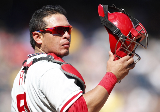 Jul 4, 2013; Pittsburgh, PA, USA; Philadelphia Phillies catcher Carlos Ruiz (51) looks into the dugout against the Pittsburgh Pirates during the ninth inning at PNC Park. The Philadelphia Phillies won 6-4. Mandatory Credit: Charles LeClaire-USA TODAY Sports