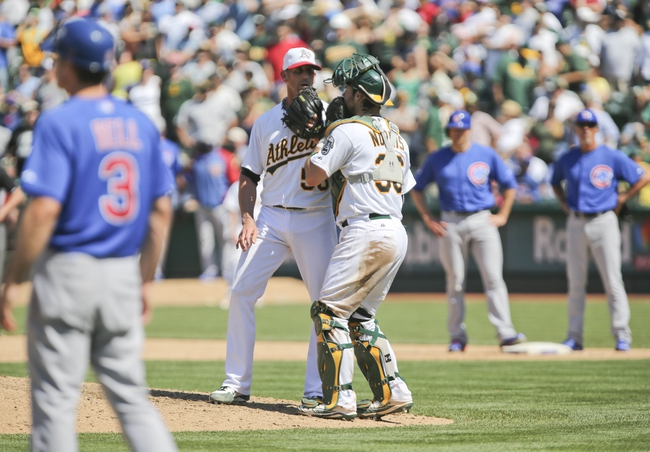 Jul 4, 2013; Oakland, CA, USA; Oakland Athletics relief pitcher Grant Balfour (50) speaks with catcher Derek Norris (36) with two Chicago Cubs runners on base during the ninth inning at O.co Coliseum. The Oakland Athletics defeated the Chicago Cubs 1-0. Mandatory Credit: Kelley L Cox-USA TODAY Sports
