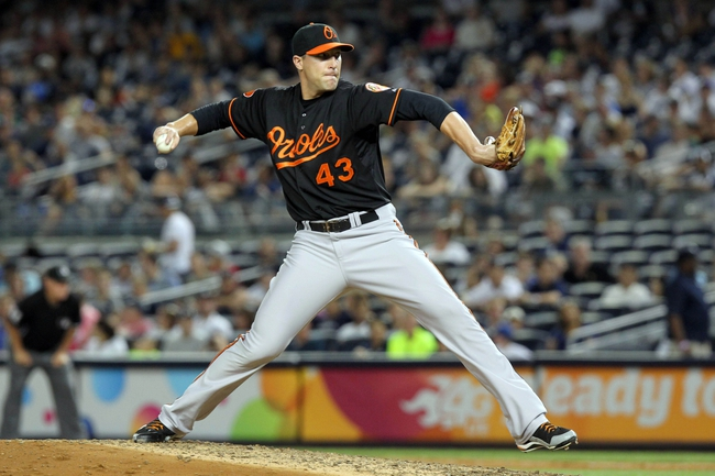 Jul 5, 2013; Bronx, NY, USA; Baltimore Orioles relief pitcher Jim Johnson (43) pitches against the New York Yankees during the ninth inning of a game at Yankee Stadium. Mandatory Credit: Brad Penner-USA TODAY Sports