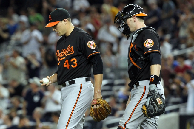 Jul 5, 2013; Bronx, NY, USA; Baltimore Orioles catcher Matt Wieters (32) talks with relief pitcher Jim Johnson (43) as he reacts after committing a fielding error against the New York Yankees during the ninth inning of a game at Yankee Stadium. Mandatory Credit: Brad Penner-USA TODAY Sports