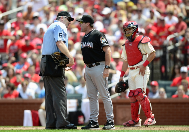 Jul 6, 2013; St. Louis, MO, USA; Miami Marlins manager Mike Redmond (11) argues with umpire Bill Welke (52) during the fourth inning against the St. Louis Cardinals at Busch Stadium. Mandatory Credit: Jeff Curry-USA TODAY Sports