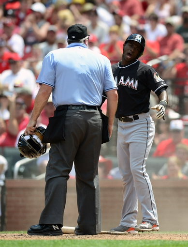 Jul 6, 2013; St. Louis, MO, USA; Miami Marlins shortstop Adeiny Hechavarria (3) reacts after being called out at home during the fourth inning against the St. Louis Cardinals at Busch Stadium. Mandatory Credit: Jeff Curry-USA TODAY Sports