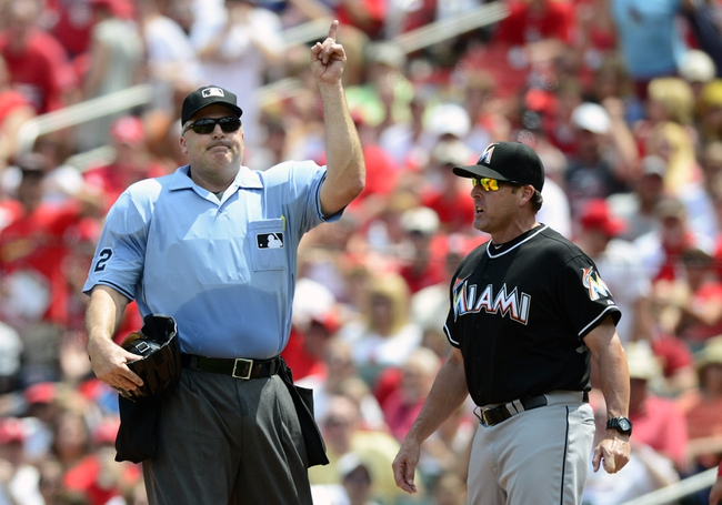 Jul 6, 2013; St. Louis, MO, USA; Miami Marlins manager Mike Redmond (11) is thrown out of the game by umpire Bill Welke (52) during the fourth inning against the St. Louis Cardinals at Busch Stadium. Mandatory Credit: Jeff Curry-USA TODAY Sports