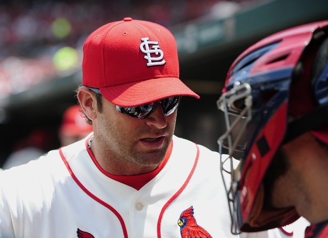 Jul 6, 2013; St. Louis, MO, USA; St. Louis Cardinals manager Mike Matheny (22) taks with catcher Tony Cruz (48) before a game against the Miami Marlins at Busch Stadium. Mandatory Credit: Jeff Curry-USA TODAY Sports