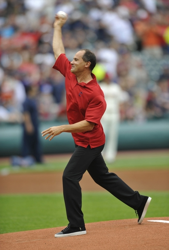 Jul 6, 2013; Cleveland, OH, USA; Cleveland Indians former shortstop Omar Vizquel throws out the first pitch before a game against the Detroit Tigers at Progressive Field. Mandatory Credit: David Richard-USA TODAY Sports